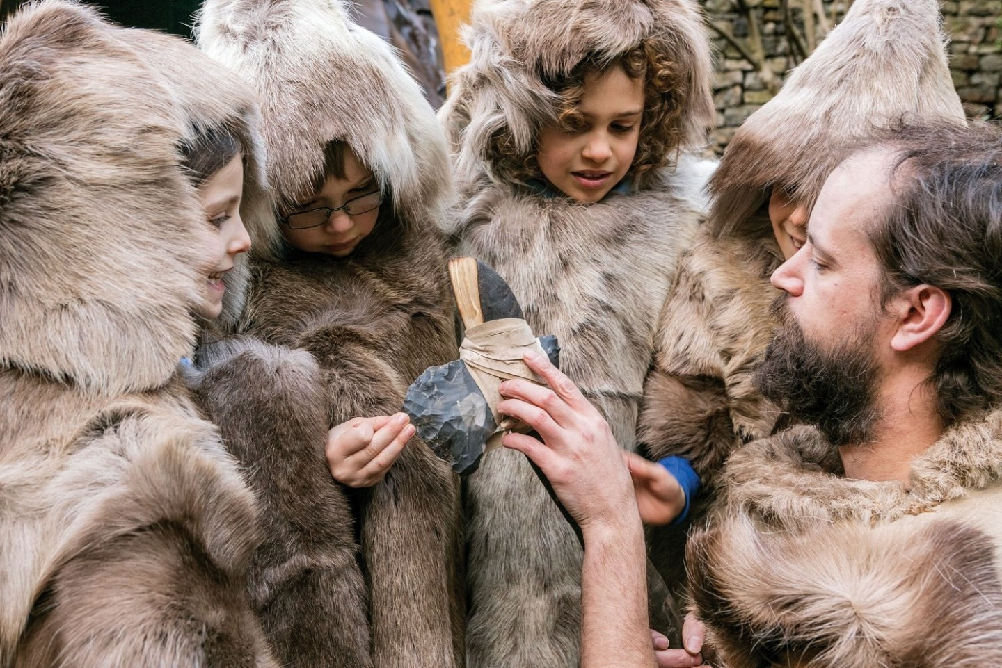 Children dressed as hunters in animal skins at Cheddar Gorge Museum